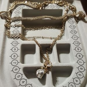 A ladies gold chains and diamond necklace